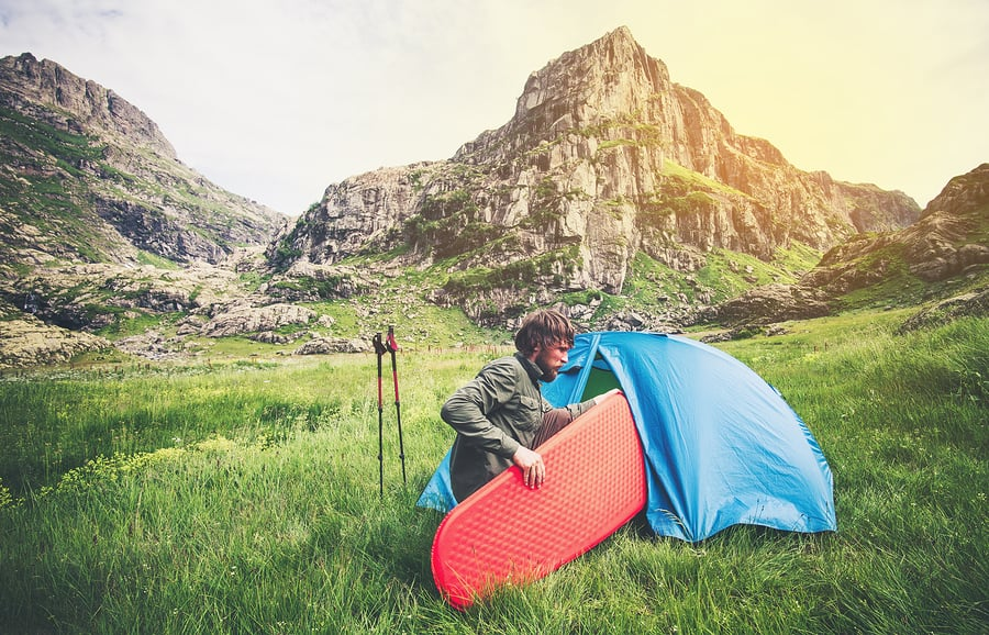 Putting a camping mat in a tent
