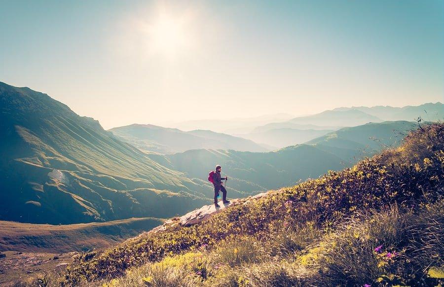 Backpacker hiking on a mountain trail